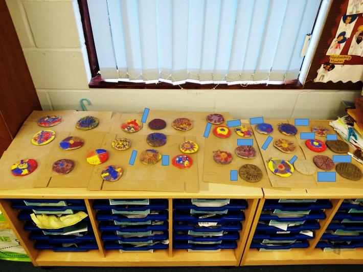 We have painted our clay brooches using primary colours, amazing!