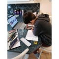 Luke studying hard