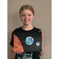 Lily has compared the sun, moon and Earth and used her acrylic paint pens.