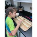 Emily making sausage rolls