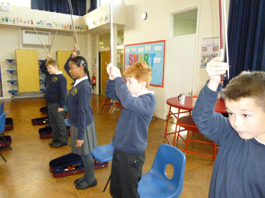 We practised the grip while moving our bows around.