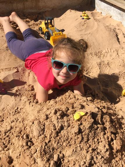 Fun in the sand pit -pretending to be at the beach