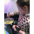 Bethany getting stuck in with the cooking!