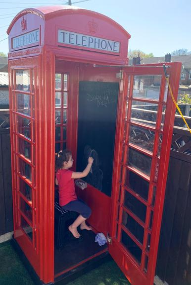 Drawing in the phone box!