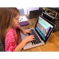 Cerys practising her typing skills