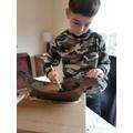 Bailey hard at work with his Viking ship