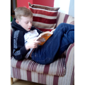 Christopher snuggled up with a good book