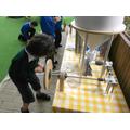 Grinding the grain to make flour.