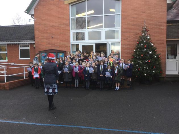 The Choir singing at the Christmas fair