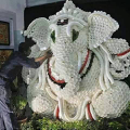 Ganesh image made from tea cups.