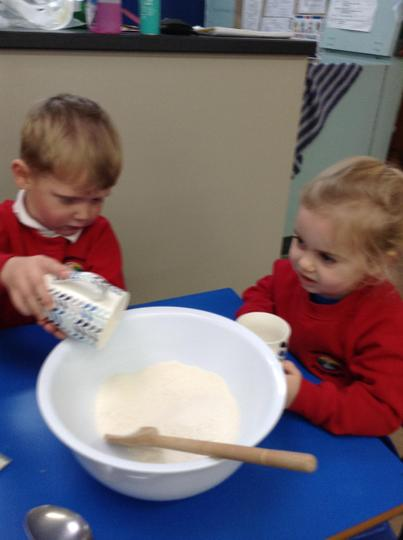 Counting the correct number of cups in our playdough recipe