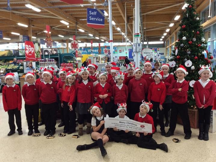 Singing for Tesco customers to say thank you