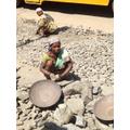 Look at the big metal pans  being used.