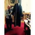 Ivor Dixon, Deputy Mayor shows us  special robes.