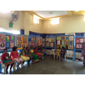 Pupils' art work in the background.