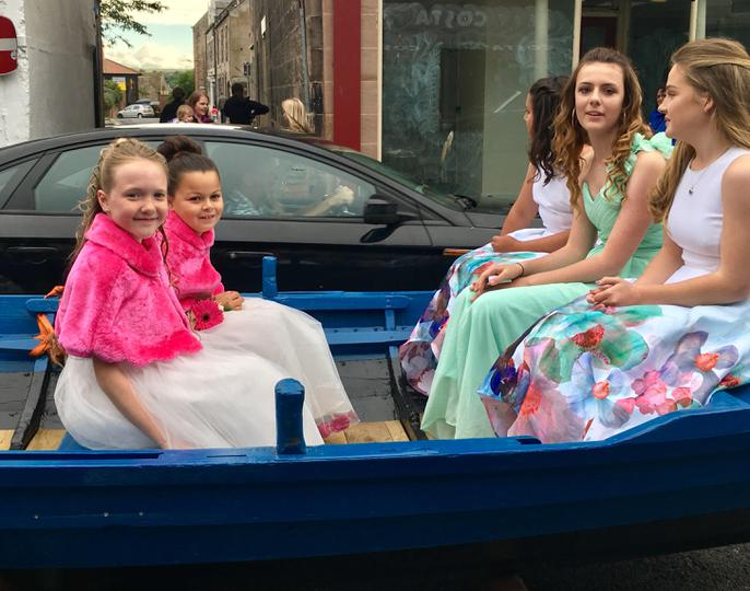 On the way to the crowning ceremony in a boat!