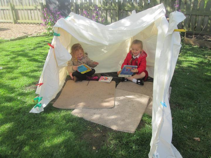 Reading stories in the tent