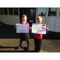 Our two pupils with their winning entries.