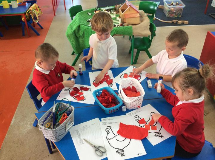 Making a collage of the Little Red Hen using different materials