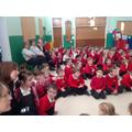 Teachers and pupils listen carefully.