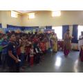 Singing the Ganapati Aarti, part of Hindu worship.