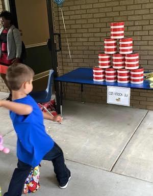 Set up can alley throwing game