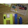 Trace the letter with the vehicles