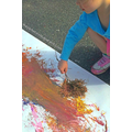 Paint using leaves as brushes and mud as paint