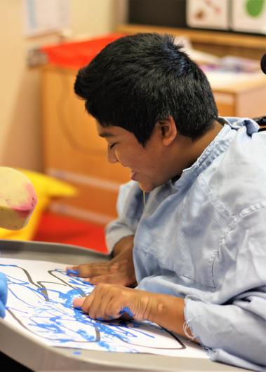 Mahdi enjoyed painting his 'M'