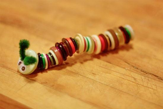 Thread buttons onto pipe cleaner