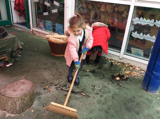 Ava is busy sweeping up!