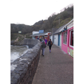 Walking along Pendine at high tide