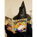 This lovely witch likes to read books under a spooky roof.
