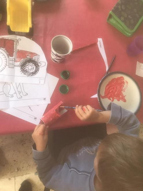 busy making a little red tractor
