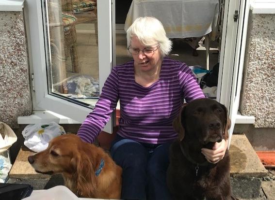 Dog cuddles with Auntie Paula