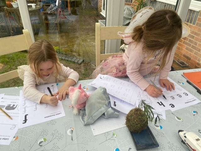 Carefully practising her letters