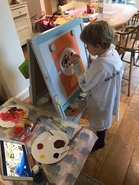 A busy art lesson at home