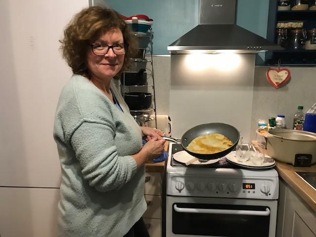 Mum making pancakes for Shrove Tuesday