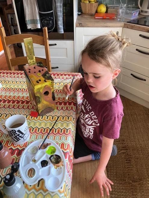 making and painting a camouflage bird box