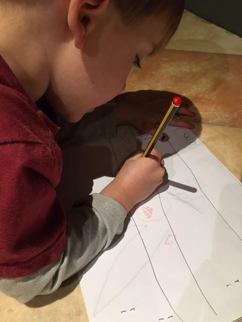 Concentrating hard on his writing