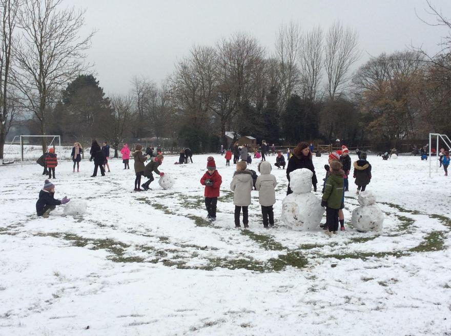 It snowed so children went outside to learn.