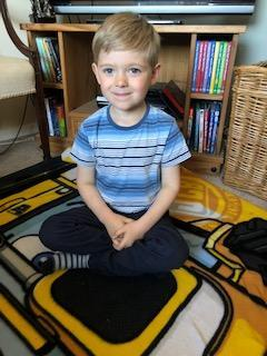 sitting on a very nice classroom mat