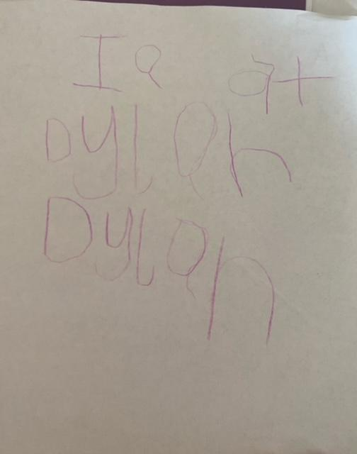 Dylan is working hard to write his name correctly
