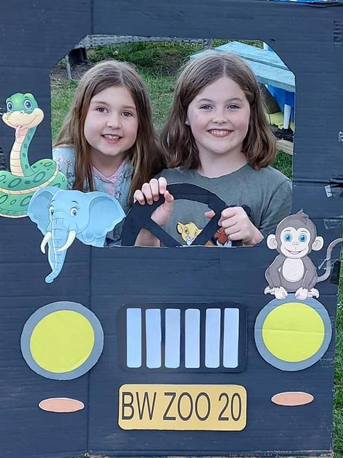 Our Girls having a photo in the Jeep we made.