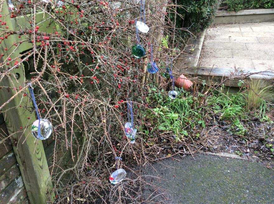 ice pendants hanging on a frosty bush