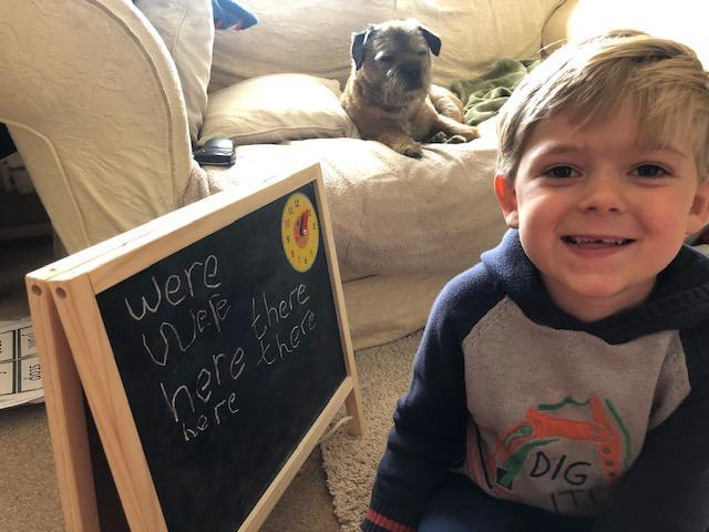 Learning words on a blackboard watched by the dog!