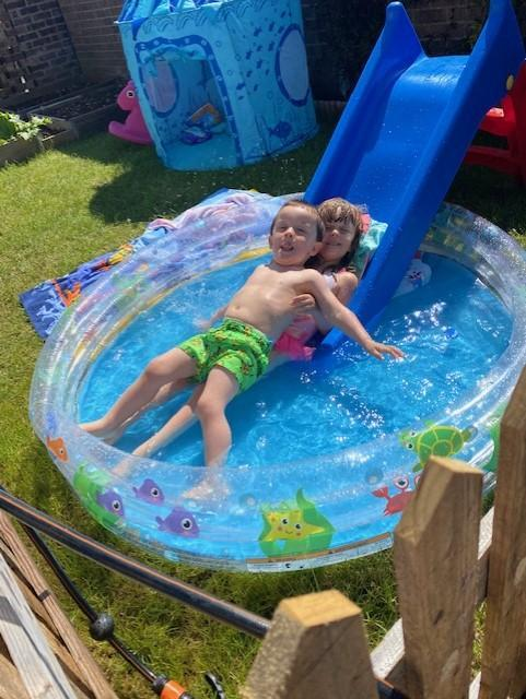 You can't beat a slide into a paddling pool!