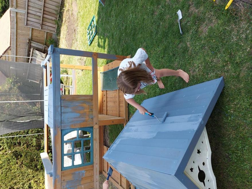 Painting the play set.