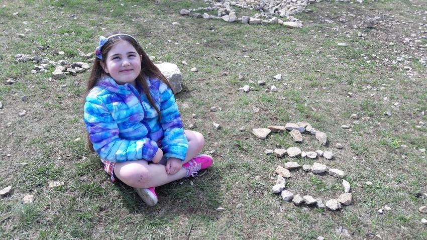 Flo with her name in stones