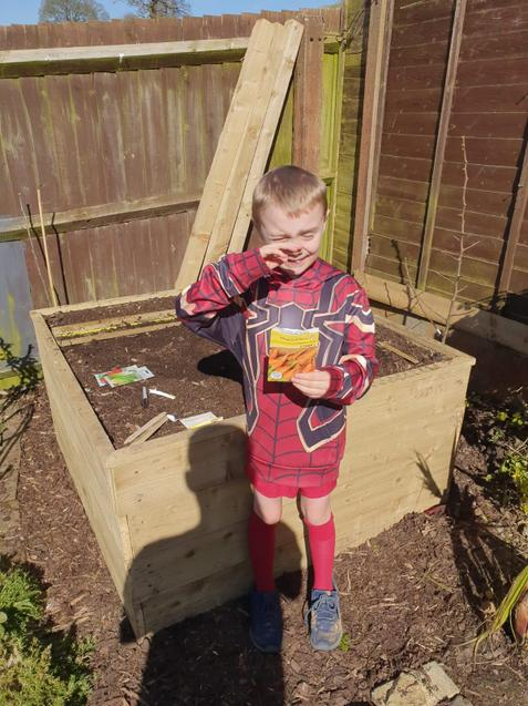 Charlie sowing seeds.